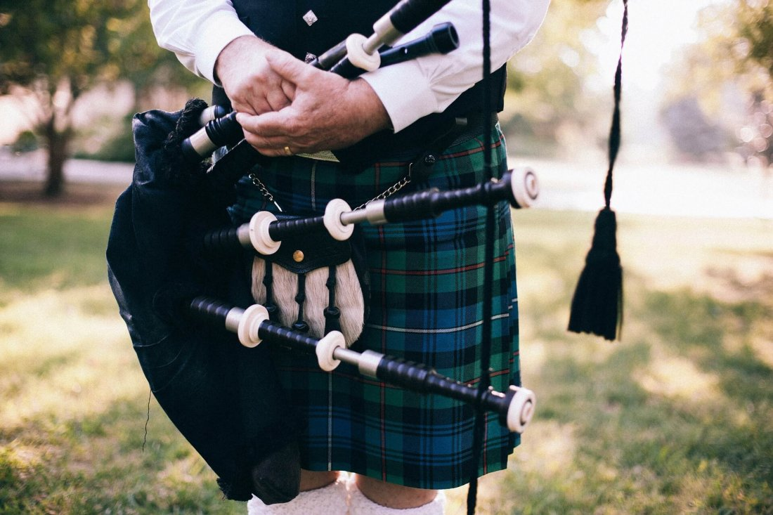 Man holding bagpipes
